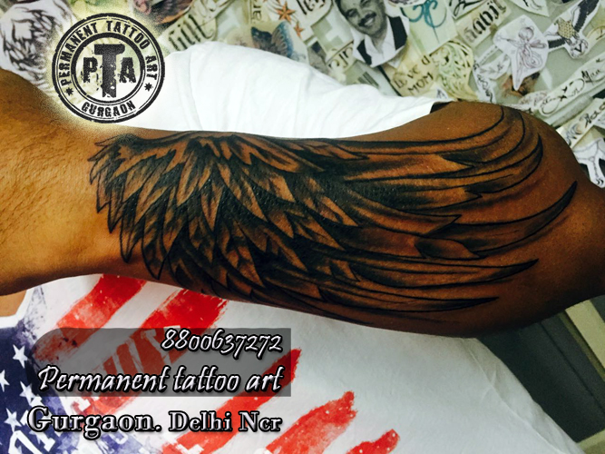 one side wings arm tattoo design Done at Permanent Tattoo Art